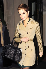 Emma Watson paired her Burberry trench coat with a matching studded shoulder bag. It must be nice to be the spoke-model for fashion brand.