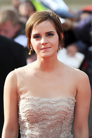 Emma Watson's brilliant brown eyes were made up in silvery tones at the world premiere of 'Harry Potter & The Deathly Hallows Part 2'.