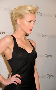 Amber Heard matched her ruby nails to her vibrant lipstick for the premiere of 'Manon' at the Metropolitan Opera.