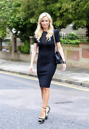 Denise van Outen rocked a pointed-shouldered LBD while out in London.