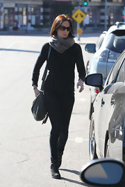Emily Blunt ran errands in LA with a black leather satchel slung over her shoulder.