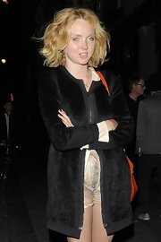 Lily Cole enjoyed a night out in London wearing a light fur coat over print shorts.