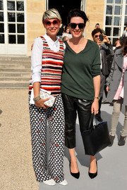 Garance Dore kept it casual in a green V-neck sweater during the Dior fashion show.