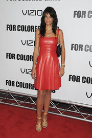 Veronica Webb towered in a pair of nude strappy platform heels. The neutral heels kept all eyes on her red leather Adam dress.