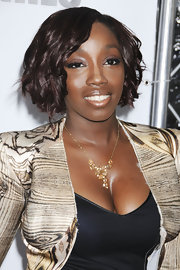British singer Estelle showed off her shoulder short curls while hitting the premiere of 'For Colored Girls'.