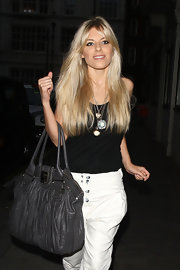 Mollie King paired her casual outfit with an eye-catching grey leather shoulder bag.