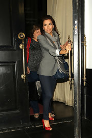 Eva Longoria gave her relaxed look a dash of color with red platform peep toes.