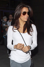 Eva Longoria kept her style relaxed in a white long-sleeve T-shirt and classic aviators.