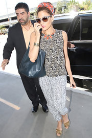 Eva Mendes got on board with the comfy pants trend when she sported these white and black  printed pants.