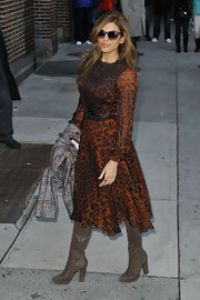 Eva Mendes dazzled in this long-sleeved, flowing, leopard print dress.