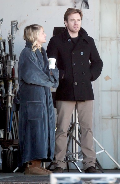 Ewan wore a classic double-breasted pea coat with khaki pants while on set.