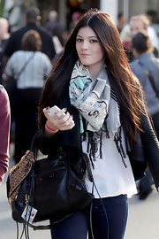Kylie Jenner wore her hair long and sleek with a center part while shopping at The Grove.