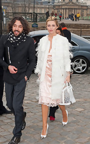 Abbey Clancy kept her spring look whimsical with a feather covered collarless coat.