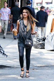 Jessica Alba styled her casual outfit with a studded black shoulder bag by Jimmy Choo.