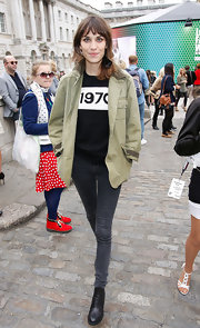 Alexa Chung finished off her cool and casual look with simple and sleek black leather ankle booties.