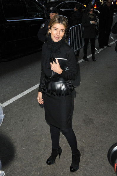 Nina Garcia pulled together her all-black look with a pair of cap-toe ankle boots during Fashion Week.