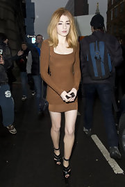 Nicola Roberts paired her fitted sweater dress with strappy black leather platform sandals with ankle straps.