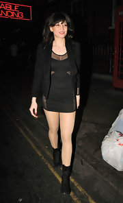 Daisy Lowe paired her micro mini dress with black leather lace up boots.