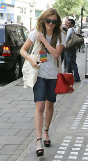 Fearne was spotting leaving Radio One donning a red leather shoulder bag.