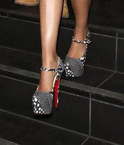 Nicki Minaj navigated some stairs in a pair of teetering polka dot Christian Louboutin pumps.