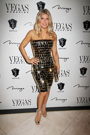 Fergie paired her dazzling strapless dress with a pair of silver heels while celebrating in Vegas.