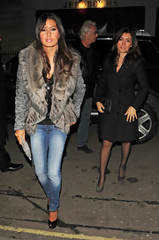 Snapped arriving at a restaurant in London, Elisabetta Gregoraci rocked a statement fur coat paired with classic blue jeans.