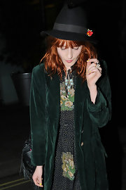 Florence donned a black fedora with a red flower while out in London.