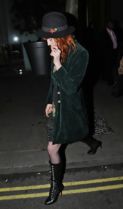 Florence Welch hit the town in black leather knee high lace up boots.