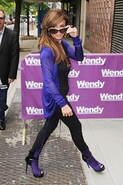 Paula Abdul matched her purple cardigan to her spunky peep-toe ankle boots.