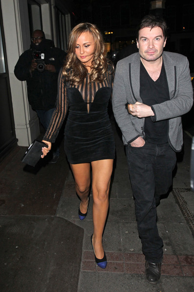 Chanelle adds some sass to the little black dress with this deep-plunging sheer style.