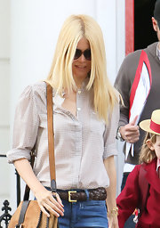 Claudia looked laid-back chic in a sheer gingham button-down while out in London.