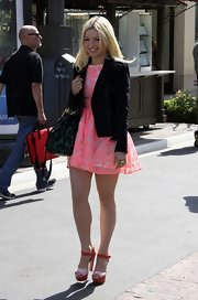 Francesca Eastwood made an appearance on 'Extra' wearing a pair of red and pink platform sandals.