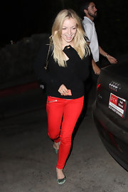 To add some bold color to her look, Francesca opted for a crimson skinny pant.
