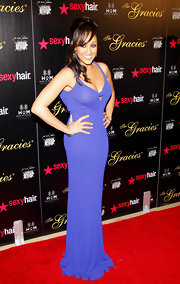 Tia Mowry attended the Gracie Awards Gala in a stunning royal blue jersey slip dress gown with keyhole detail.