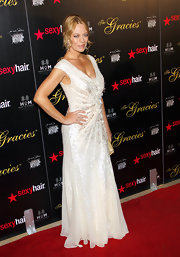 Jeri Ryan wore a glamorous ivory cap sleeve beaded gown to the Gracie Awards Gala.
