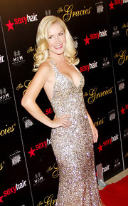 Angela Kinsey arrived at the Gracie Awards Gala looking ultra-glamorous in a gold ombre beaded halter gown.
