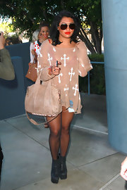 Vanessa White looked boho chic in a distressed beige sweater with a cross print.
