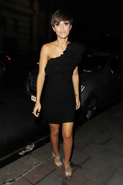 Frankie Sandford hit the town in a flirty black dress with a single ruffled shoulder.