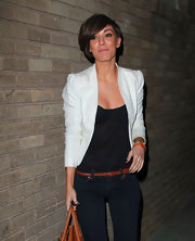 Frankie Sandford added pop to her all black attire with a white open front blazer.
