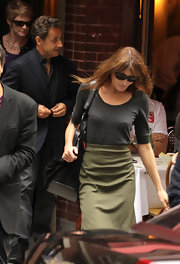Carla turned a basic gray shirt into a chic outfit by tucking it into an olive green skirt.