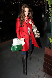 Denise Richards was right on trend in a pair of chic chocolate suede over-the-knee boots while out for dinner.