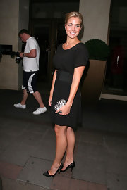 Gemma completed her evening look with classic black pumps.