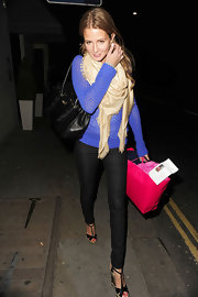 Millie Mackintosh accented her outfit by wrapping a Louis Vuitton shawl around her neck.
