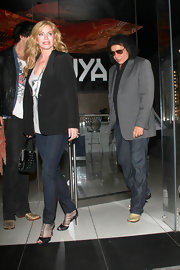 Shannon Tweed kept a leather purse on hand while out at Katsuya with her family.