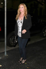 Shannon Tweed donned a street stylish ensemble featuring a vintage tank, a pair of skinny jeans and a black blazer.