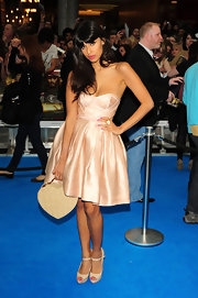 Nude peep-toe pumps paired perfectly with Jameela's pretty soft pink dress.