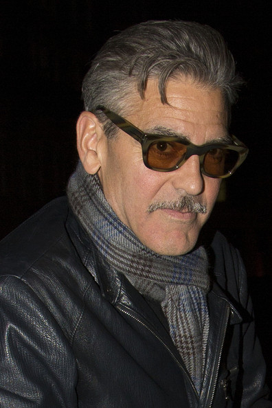 George Clooney opted for a pair of army green wayfarers for his cool and classic look while out in London.