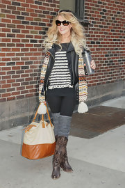 Elizabeth Cook paired a colorful patterned scarf with an edgy leather jacket for an unexpected but cool daytime look.
