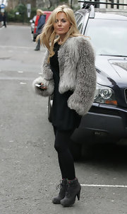 Geri Halliwell stepped out in gray suede lace up ankle boots, which she paired with black leggings.