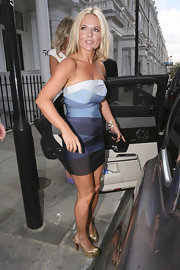 Geri donned an Herve Leger mini dress with metallic, platform slingbacks.